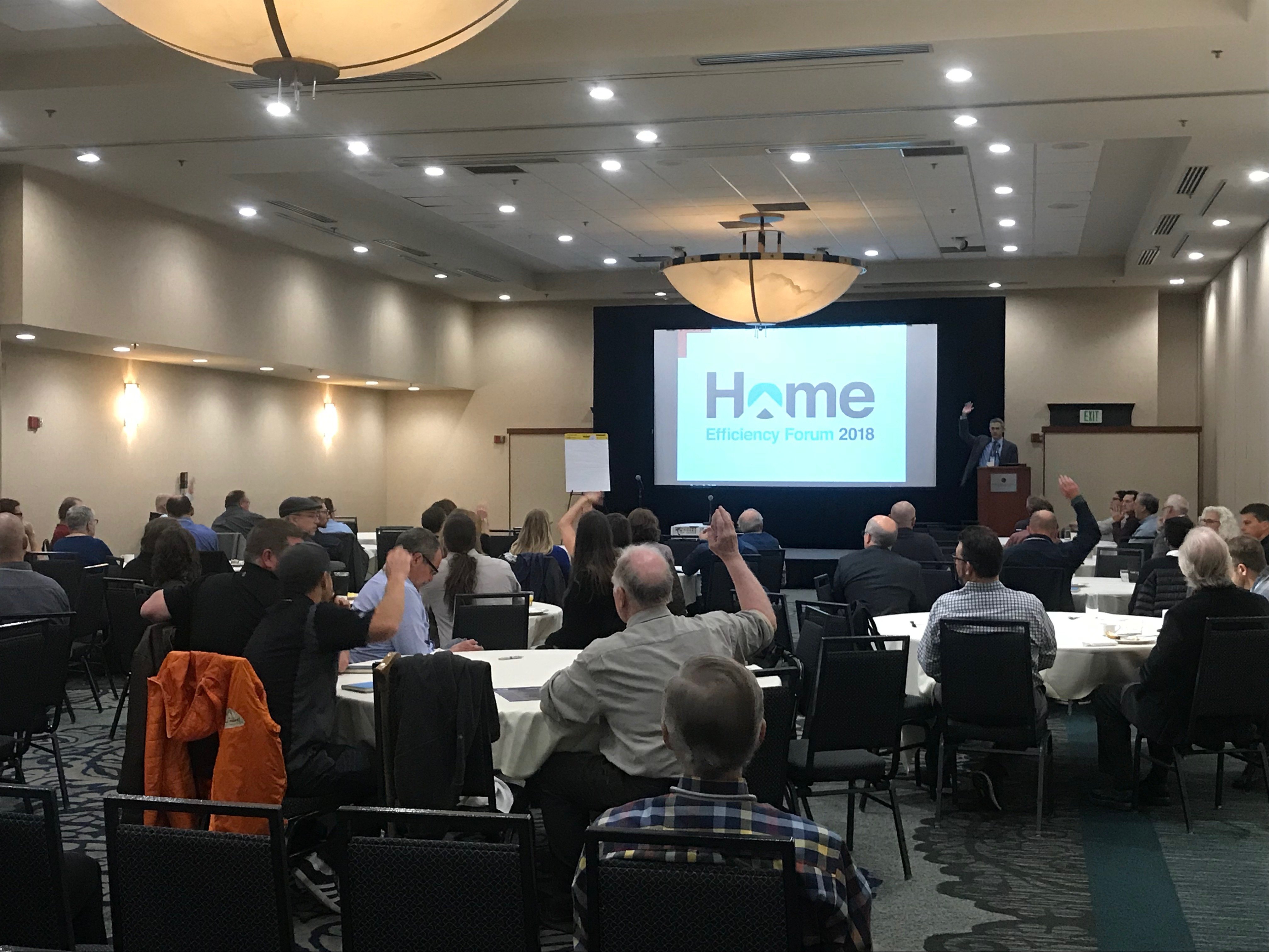 People viewing presentation in conference space for HEF 2018.